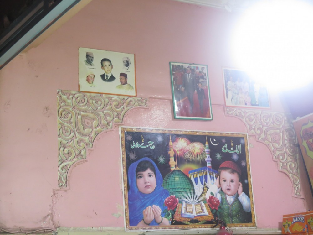 poster on a shop-wall showing praying children