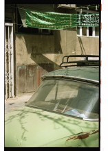 Car and Islamic banner (يافطة) in Damascus, Syria